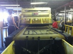 Used Herman Schwabe Out feed with convenient and efficient parts conveyor