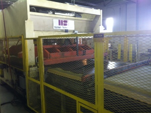 Used Herman Schwabe SR 300 Out feed with convenient and efficient parts conveyor