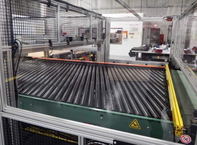 Powered Bias Conveyor for Slab Alignment