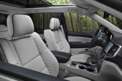 "Jeep Grand Cherokee Summit ""Gorgeous semi-aniline leather, open pore wood, and even plastics tinted in unusual shades help the Grand Cherokee stand out in a sea of average SUVs and crossovers"""